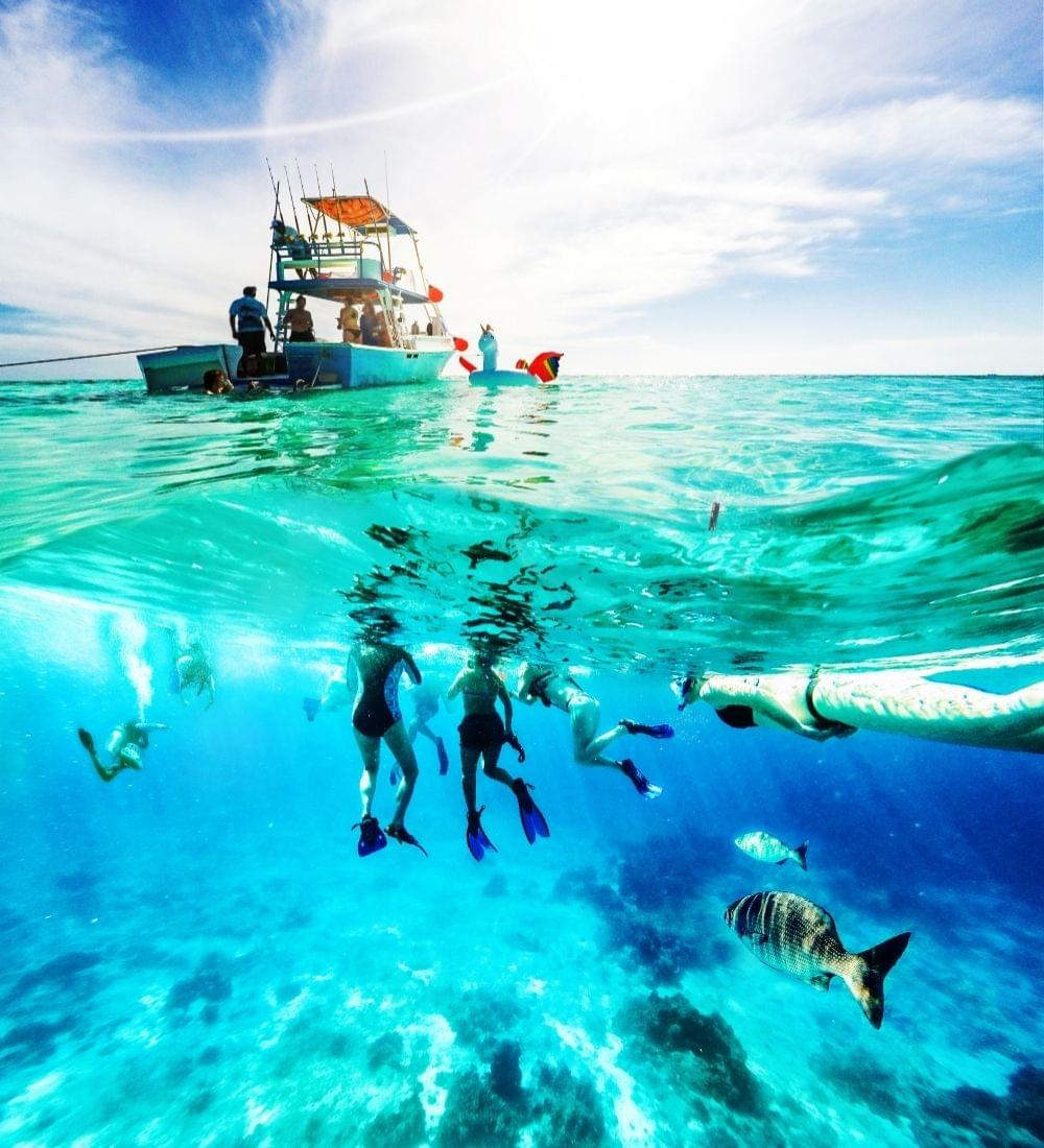 caribbean dive boat with underwater divers tropical