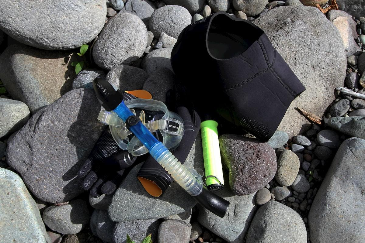 dry snorkel with gear on rocks