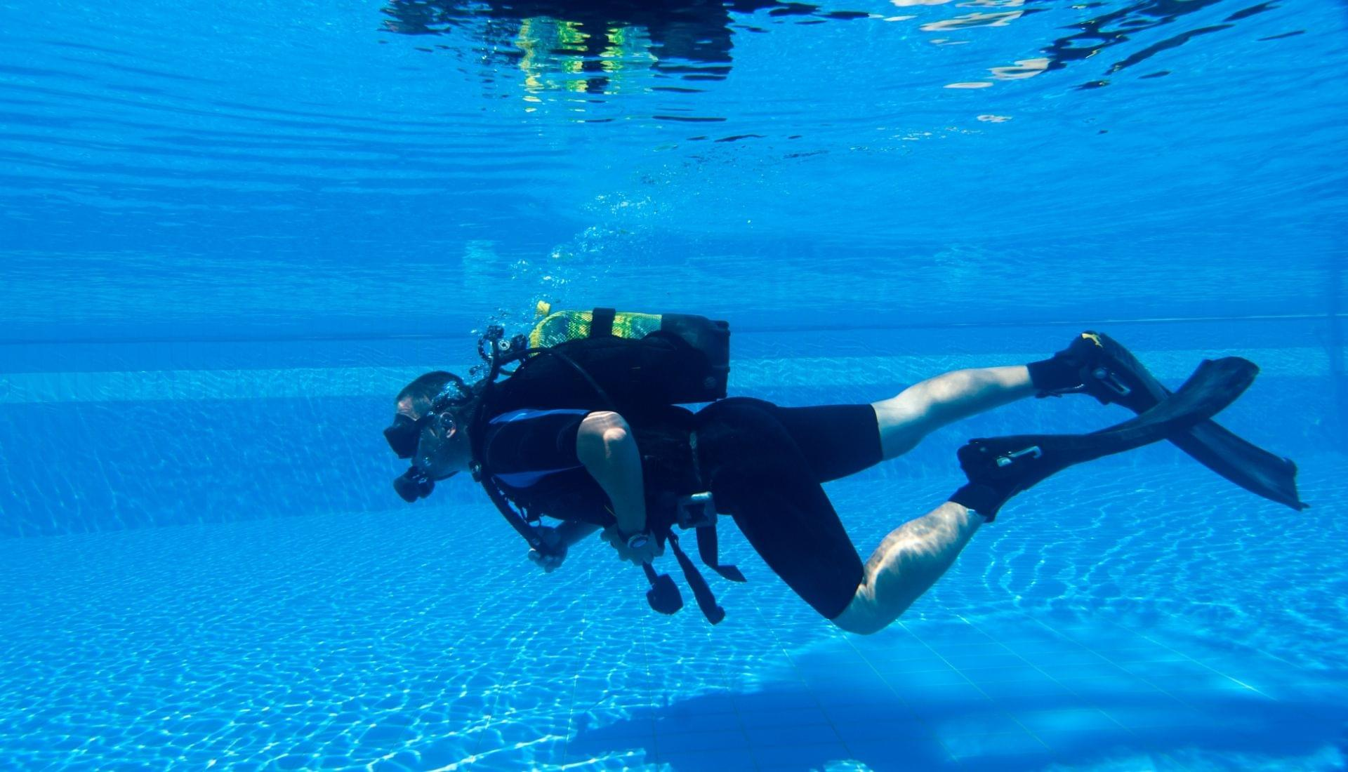 scuba diver practicing in pool